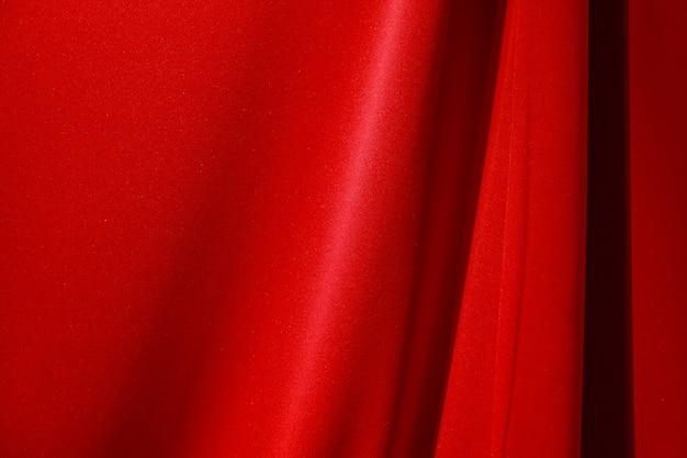 Rotes stofftuch mit schatten für hintergrund Premium Fotos