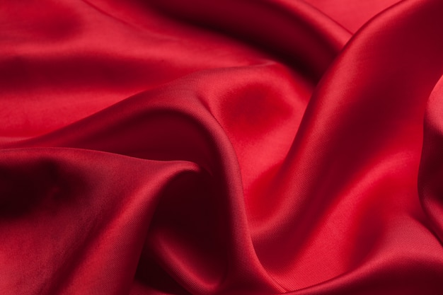 Rotes tuch bewegt beschaffenheit wellenartig Premium Fotos