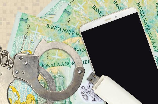 Rumänische leu rechnungen und smartphone mit polizei handschellen Premium Fotos