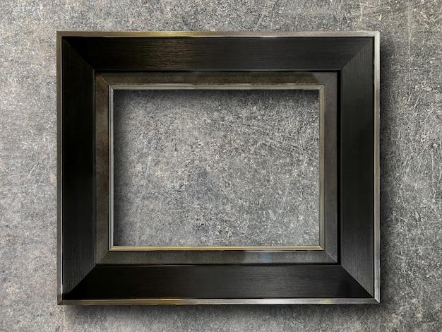 Rustikaler bilderrahmen auf zementwand Premium Fotos