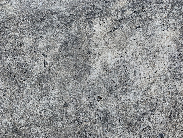 Rustikaler zementwand-beschaffenheitshintergrund des kratzers Premium Fotos