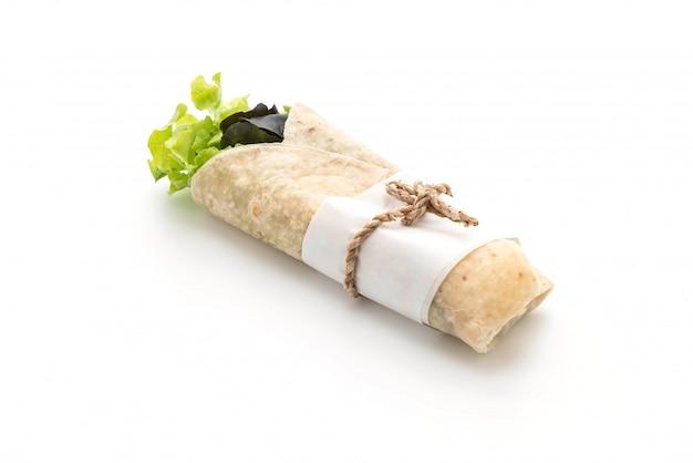 Salatrolle einwickeln Premium Fotos