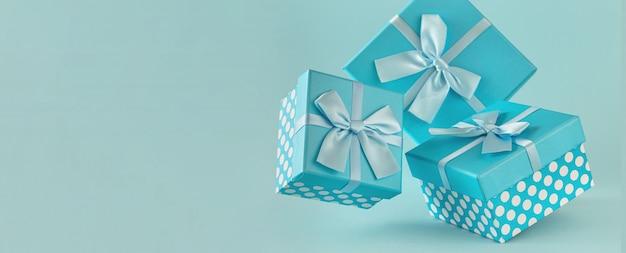 Sammlung von blauen geschenkboxen mit bändern Premium Fotos