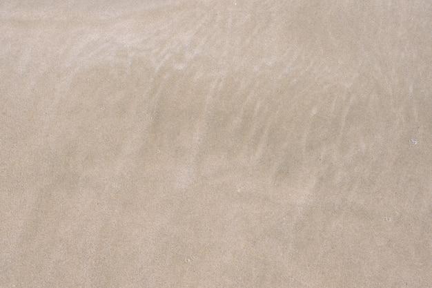 Sandbeschaffenheit sandstrand für hintergrund. Premium Fotos