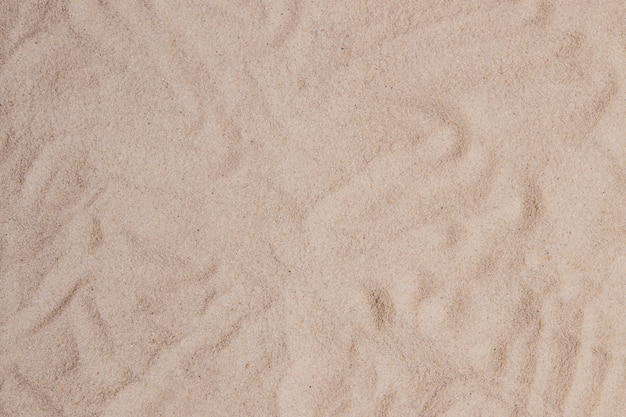 Sandoberfläche mit abstrakten formen Premium Fotos