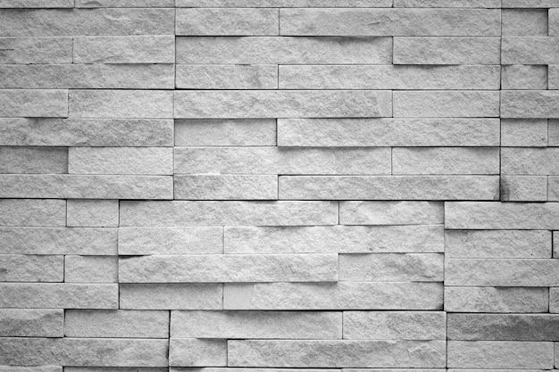 Sandsteinziegelstein für strukturierten hintergrund Premium Fotos