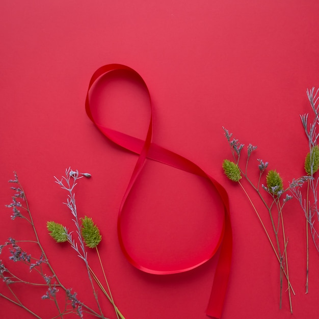 Satin rotes band in form von 8 Premium Fotos