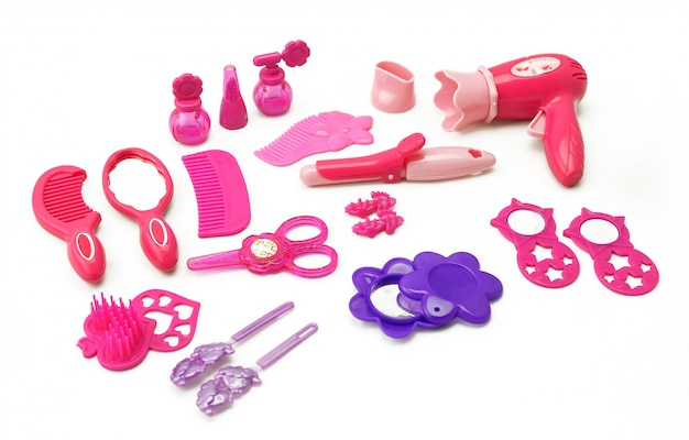 Satz des spielzeugs der kinder für den mädchenspiel-frisörsatz für die mädchen lokalisiert auf weiß Premium Fotos