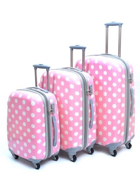 Satz rosa koffer groß, mittel und klein lokalisiert Premium Fotos