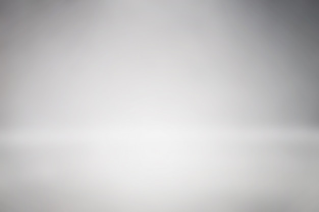 Sauberes raumstudio-hintergrundzusammenfassungs-steigungsgrau Premium Fotos