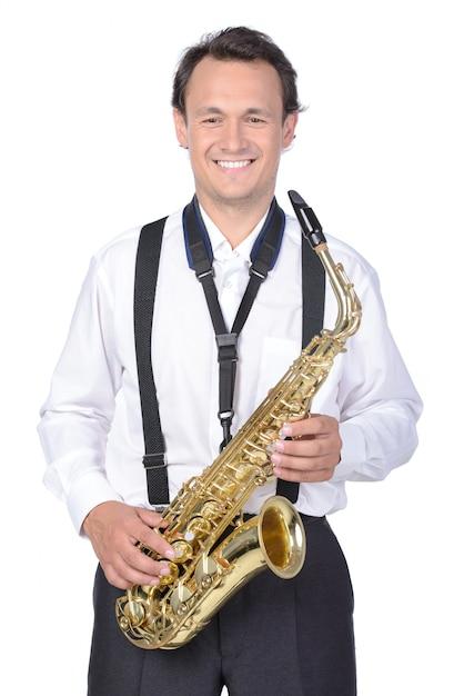 Saxophonist im weißen hemd Premium Fotos