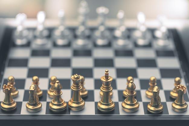 Schachspiel, setze das brett auf gold und silber Premium Fotos