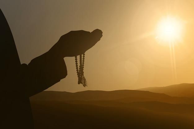 Schattenbilder der moslemischen leute, die zum gott beten Premium Fotos
