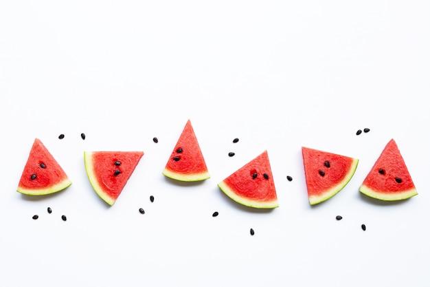 Scheiben der wassermelone mit den samen lokalisiert auf weiß Premium Fotos