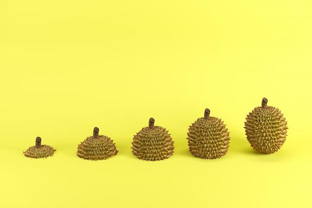 Scheiben des reifen durians auf gelbem hintergrund minimales fruchtideenkonzept. Premium Fotos