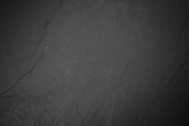 Schieferbrett auf schwarzem holz Premium Fotos
