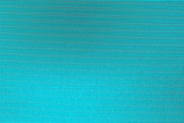 Schließen sie herauf geführte blaue punkte der schirmbeschaffenheit beleuchten abstrakten hintergrund von geführtem computermonitorschirm Premium Fotos