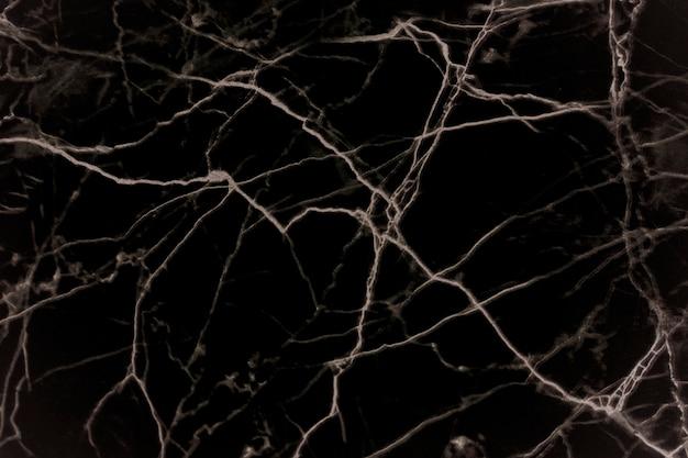 Schließen sie oben vom schwarzen marmorhintergrund Kostenlose Fotos
