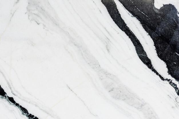 Schließen sie oben von einer strukturierten wand des schwarzweiss-marmors Kostenlose Fotos