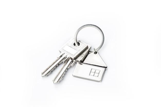 Schlüssel auf weißem? purchase-konzept platziert Premium Fotos