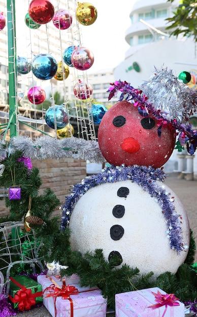 Schneemanndekoration für frohe weihnachten und ein gutes neues jahr Premium Fotos
