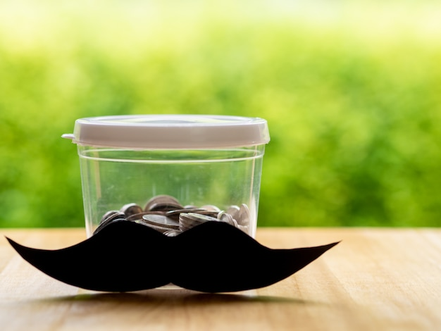 Schnurrbart mit sparschwein Premium Fotos