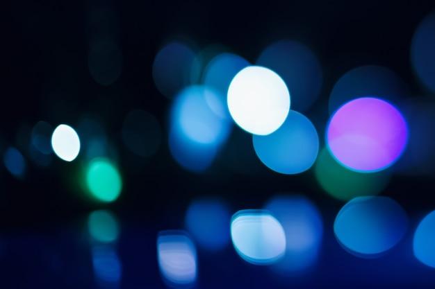 Schöne bokeh lichter auf dunklem hintergrund Premium Fotos