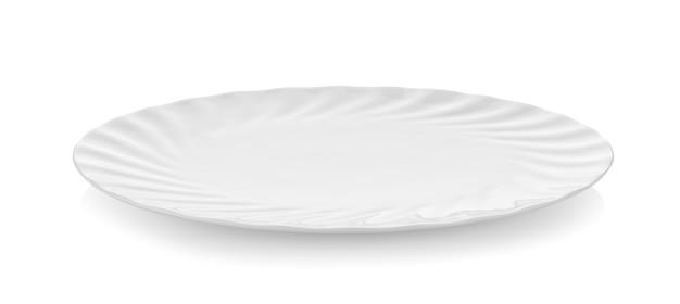 Schöne form keramikplatte auf weißer wand Premium Fotos