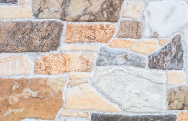 Schöne steinziegelstein-wandbeschaffenheit der nahaufnahme Premium Fotos