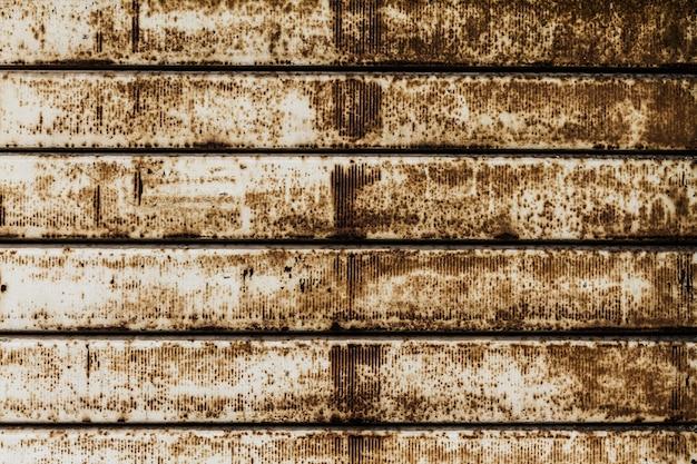 Schöne textur der grunge rusty streifen wand. horizontal. muster. rostiger hintergrund. Kostenlose Fotos