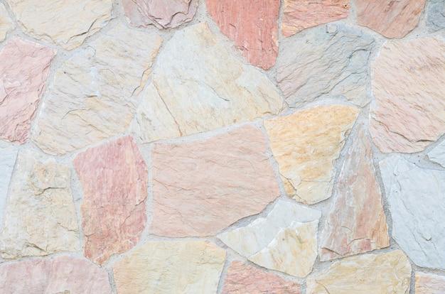 Schöner steinziegelsteinwand-beschaffenheitshintergrund der nahaufnahme Premium Fotos
