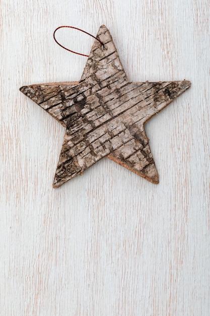 Schöner stern der birkenrinde. bereiten sie für weihnachtsgruß vor. Premium Fotos