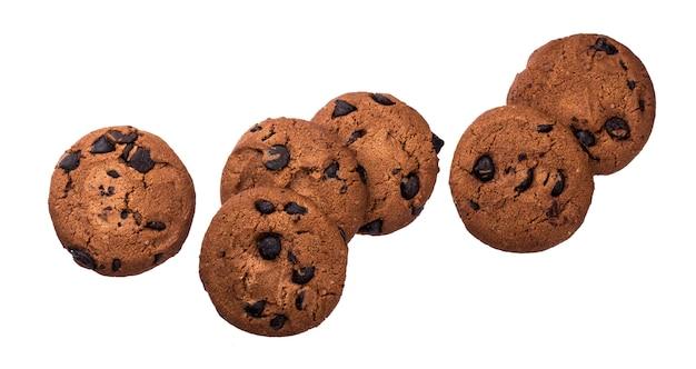 Schokoladensplitterplätzchen getrennt auf weißem hintergrund Premium Fotos
