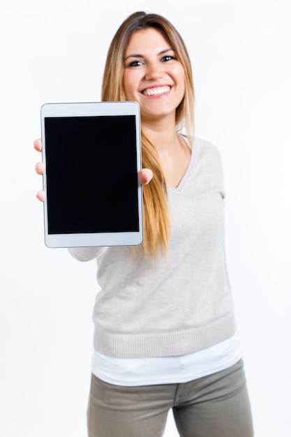 sch ne frau zeigt digitale tablette isoliert auf wei download der kostenlosen fotos. Black Bedroom Furniture Sets. Home Design Ideas