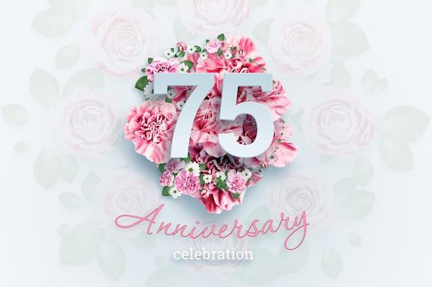 Schriftzug 75 zahlen und jubiläumsfeier text auf rosa blüten. Premium Fotos