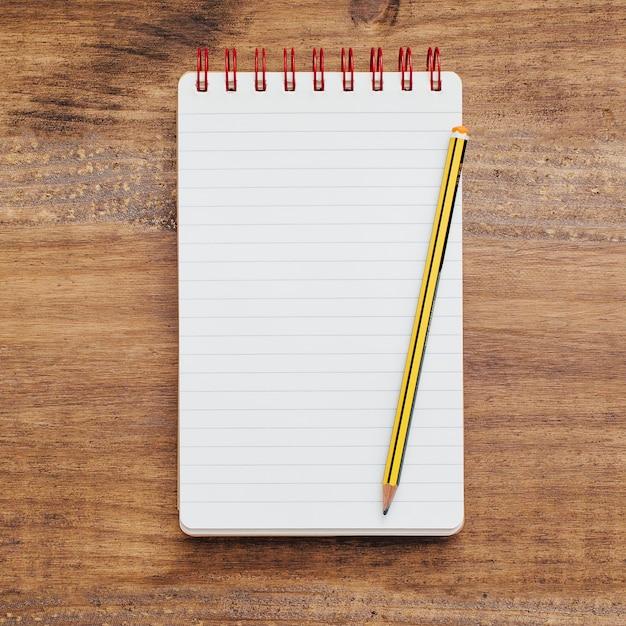 Schulnotizbuch mit Kopienraum und einem Bleistift Kostenlose Fotos