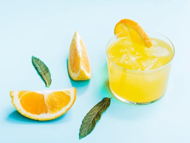 Schuss kaltes orangensaftgetränk Kostenlose Fotos
