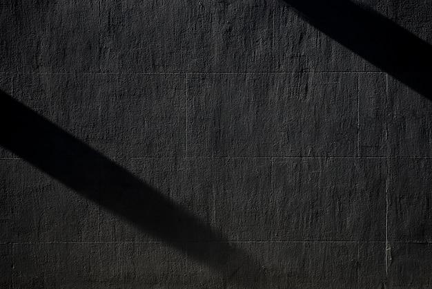 Schwarze betonmauer mit schatten Premium Fotos
