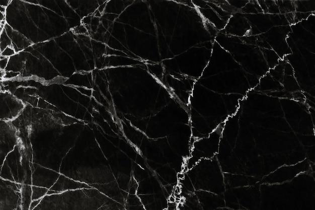 Schwarze marmorbeschaffenheit mit natürlichem musterhintergrund Premium Fotos
