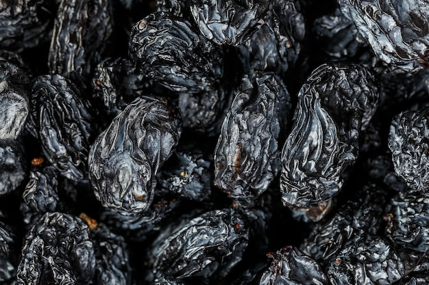 Schwarze rosinenbeschaffenheit, populäre trockenfrüchte Premium Fotos