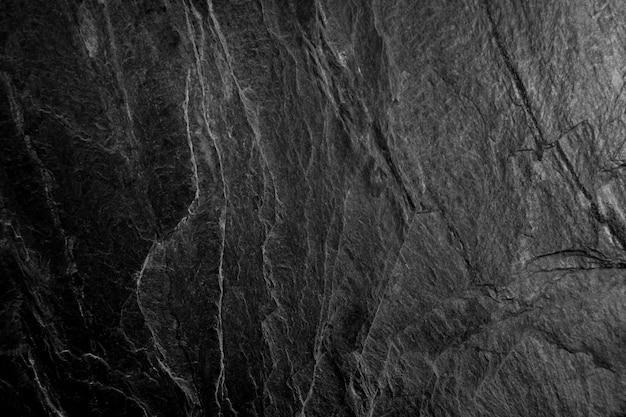 Schwarze steinoberfläche Premium Fotos