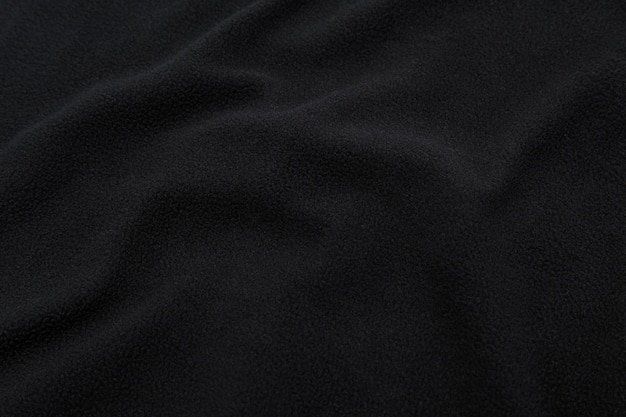 Schwarze stoffbeschaffenheit, stoffmusterhintergrund. Premium Fotos