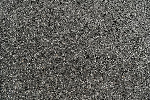 Schwarzer asphalt-asphalt-straßenbeschaffenheitshintergrund Premium Fotos