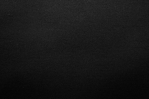 Schwarzer gewebebeschaffenheitshintergrund. detail des segeltuchtextilmaterials. Premium Fotos