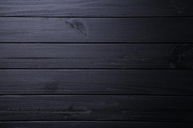 Schwarzer hölzerner hintergrund oder hölzerne beschaffenheit, hölzernes brett Premium Fotos
