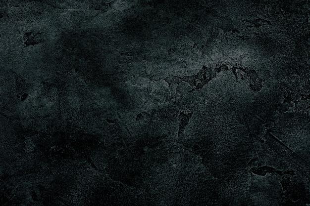 Schwarzer marmor oder konkreter hintergrund Premium Fotos