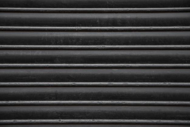 Schwarzer metallwandhintergrund Kostenlose Fotos