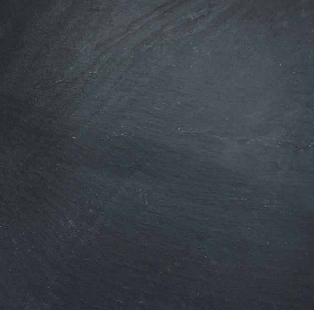 Schwarzer stein hintergrund Premium Fotos