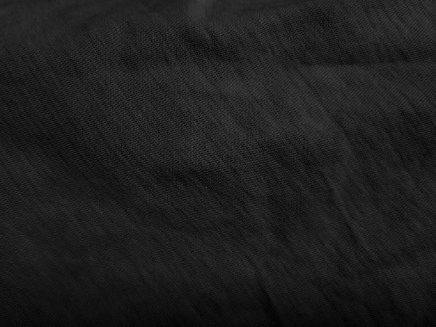 Schwarzer stoff abstrakter texturhintergrund. Premium Fotos