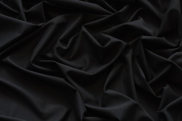 Schwarzer stoff hintergrund und textur, gerillt aus schwarzem stoff abstrakt Premium Fotos